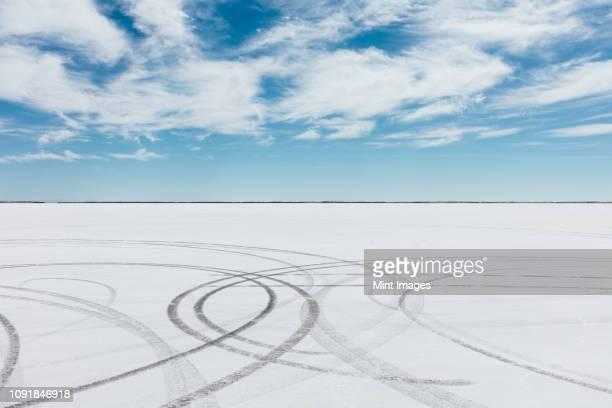 tire tracks on salt flats at dawn - bonneville salt flats stock pictures, royalty-free photos & images