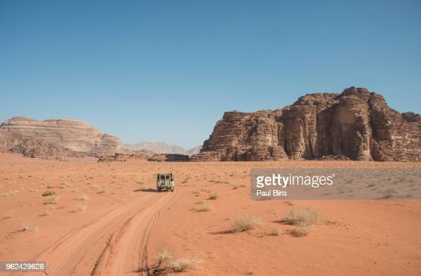 tire tracks on wadi rum desert against clear sky, jordan - jordan middle east stock pictures, royalty-free photos & images
