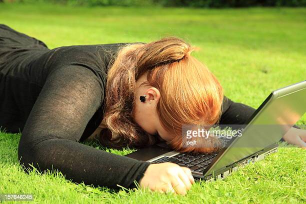 tired and frustrated young woman with laptop - pejft stock pictures, royalty-free photos & images