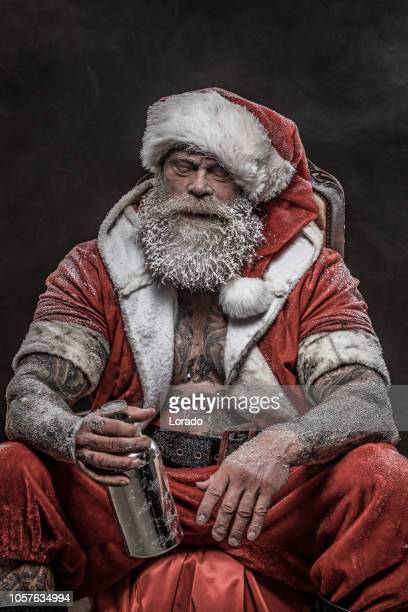 tired bad santa claus - dirty santa stock pictures, royalty-free photos & images