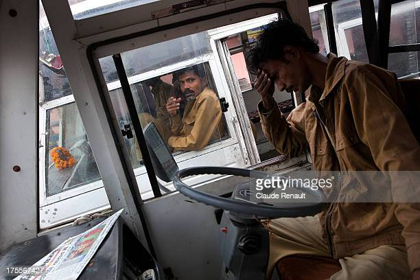 Tired bus driver waiting to go to Amber. Jaipur.