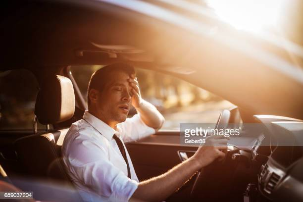 tired businessman in pain - drive sportbegriff stock-fotos und bilder