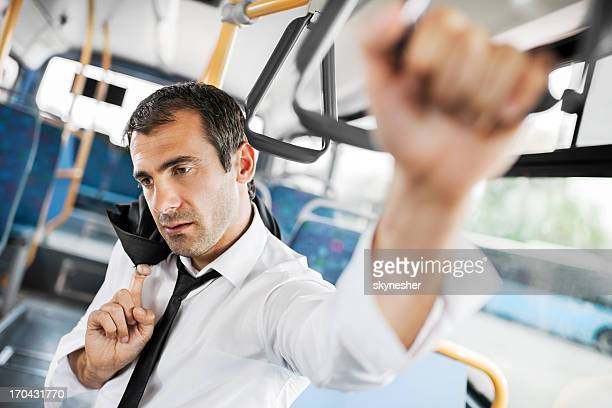 Tired businessman on a bus.