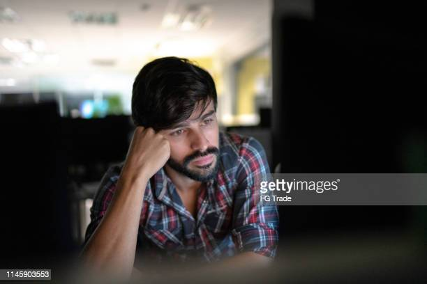 tired businessman working late - wasting time stock pictures, royalty-free photos & images