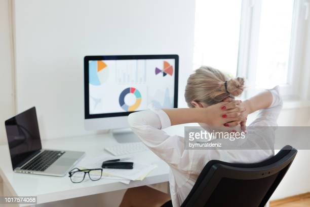 tired businesswoman at office - shoulder stock pictures, royalty-free photos & images