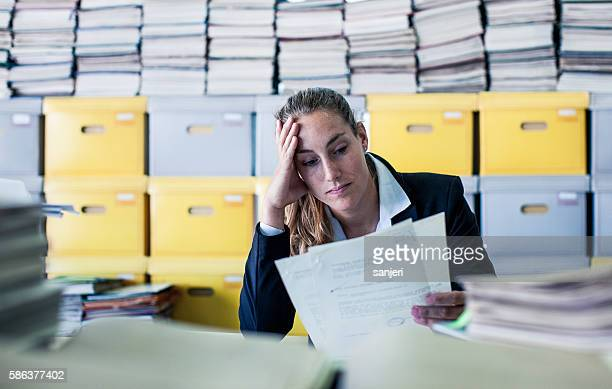 tired businesswoman in the office - overworked stock pictures, royalty-free photos & images
