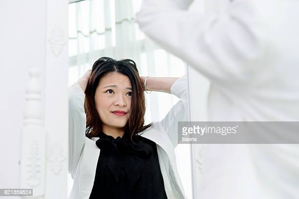 tired businesswoman looking at herself - ugly asian woman stock photos and pictures