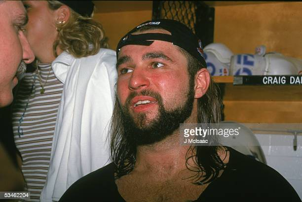 Tired Canadian hockey player Frank Bialowas of the Philadelphia Phantoms answers qurestions in the locker room during the 1998 Ceder Cup.