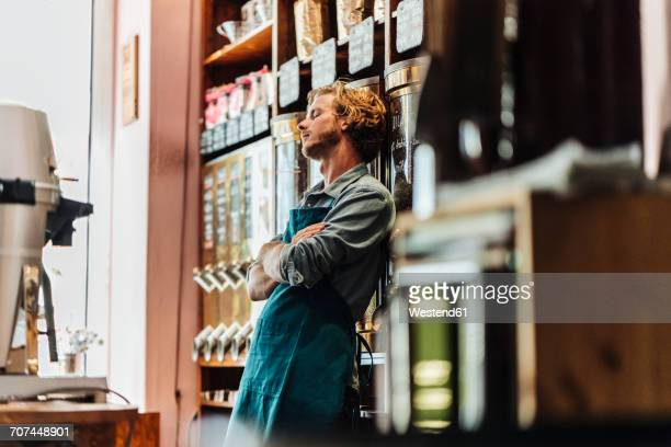 tired coffee roaster in his shop - assistant stock pictures, royalty-free photos & images
