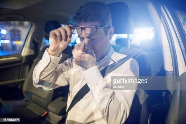 tired driver inside car at night - tired stock pictures, royalty-free photos & images
