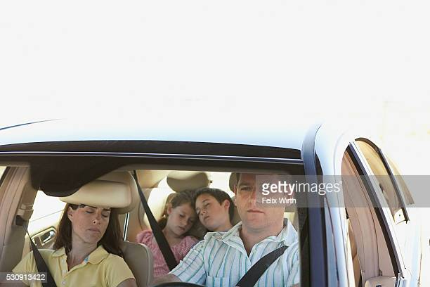 Tired family in car