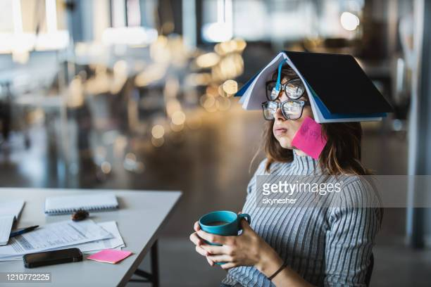 tired female student having fun with two pairs of eyeglasses. - economist stock pictures, royalty-free photos & images