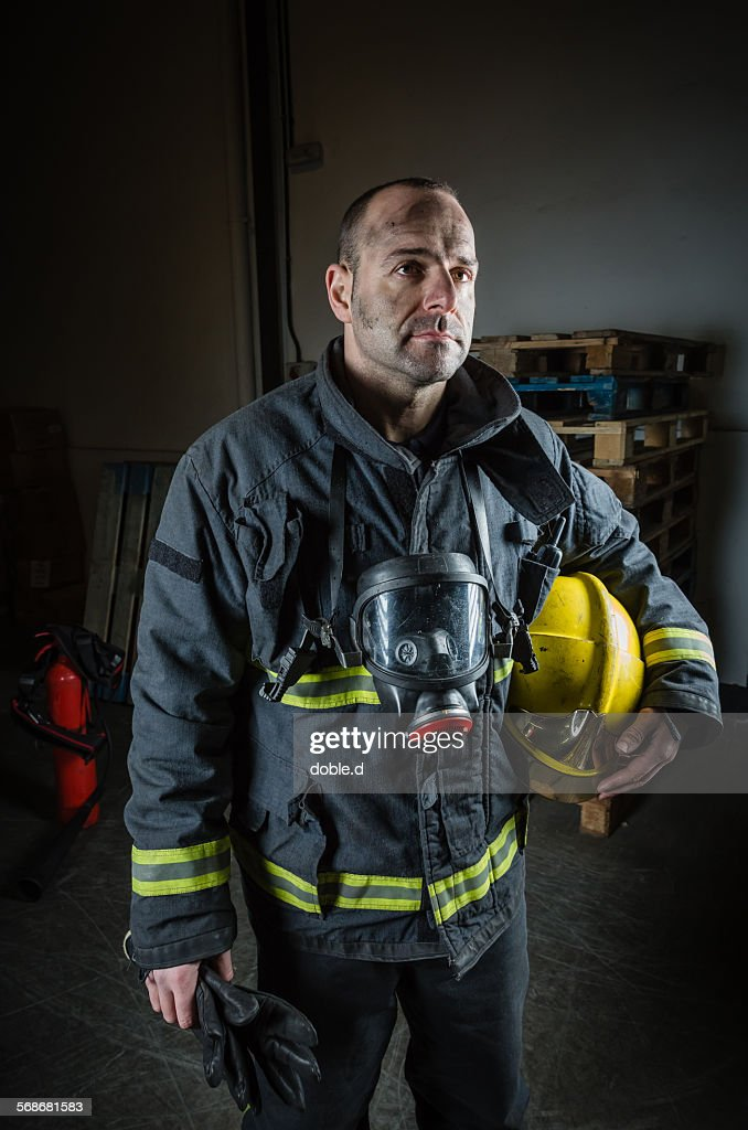 Tired firefighter after a emergency intervention : Stock Photo