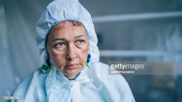tired frontline worker with protective suit during covid-19 - tired stock pictures, royalty-free photos & images