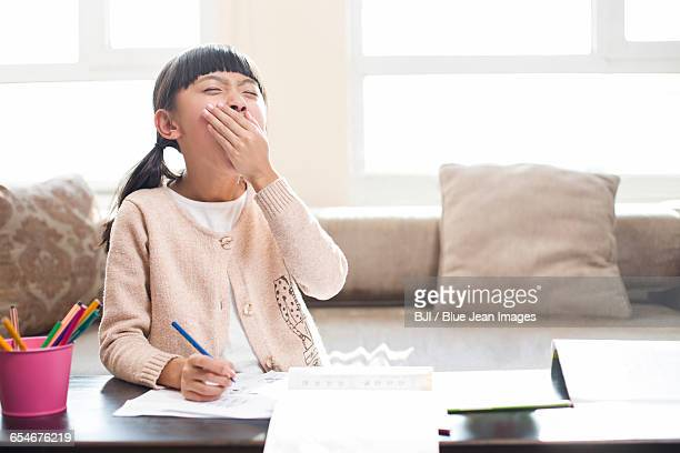tired girl doing homework - only girls stock pictures, royalty-free photos & images