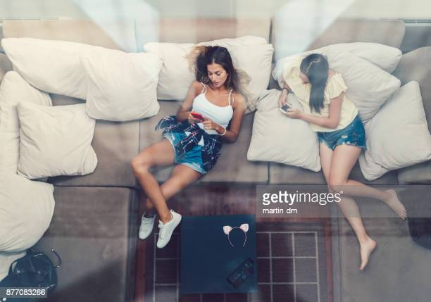 tired girls resting after arrival - laziness stock pictures, royalty-free photos & images
