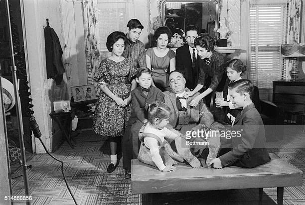 A tired Henry B Gonzalez is surrounded by his wife and their eight children who try to make him comfortable after yesterdays election win of the seat...