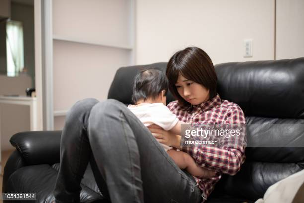 tired housewife taking care of baby - baby depression stock pictures, royalty-free photos & images