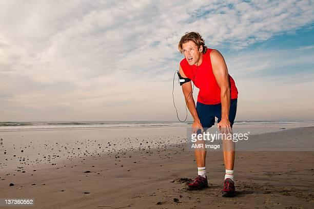 Tired jogger on a beach