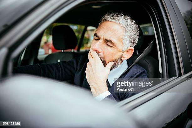 Tired man driving car