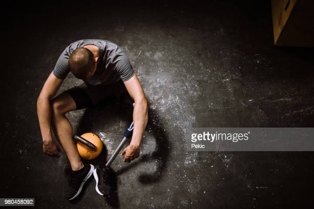 tired man with differing ability resting of  lifting barbell - artificial limb stock photos and pictures