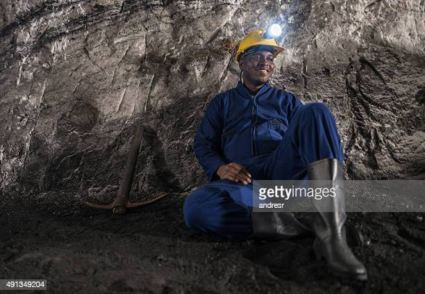 Tired man working at a mine