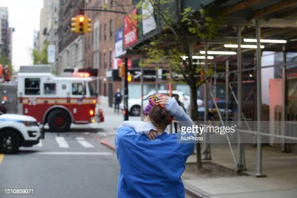 Tired nurse leaves Mt. Sinai Morningside Hospital in New York City, Thursday, 23 April, 2020.