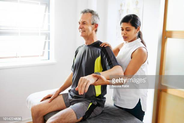 tired of joint aches and pains? - shoulder stock pictures, royalty-free photos & images