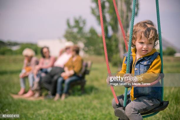 tired on a swing - autism awareness stock pictures, royalty-free photos & images
