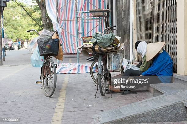 Tired scavengers in capital of Vietnam, Hanoi. They sell what they found.