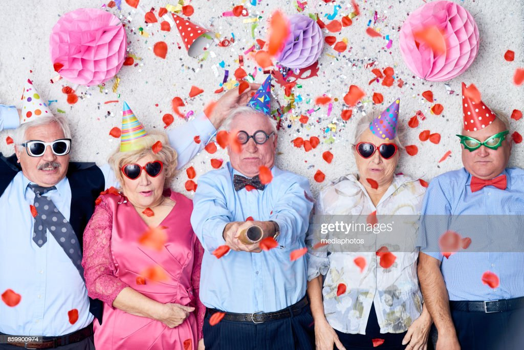Tired seniors after Christmas party : Stock Photo
