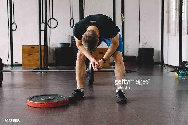tired sportsman in the gym - failure stock photos and pictures