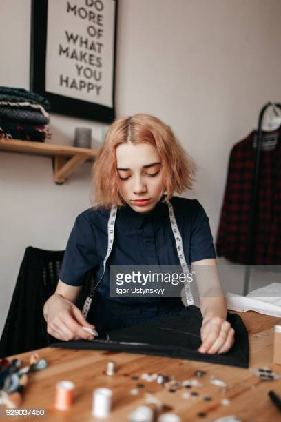 Tired tailor at her workplace