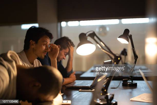 tired team resting at the workplace - monday stock pictures, royalty-free photos & images