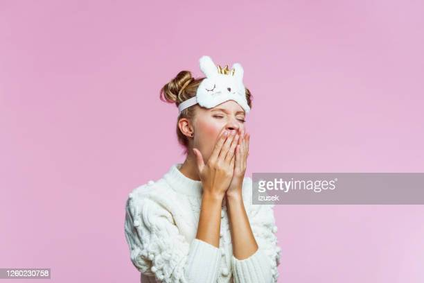 tired teenage girl with kitten blindfold sleep mask - sleeping stock pictures, royalty-free photos & images