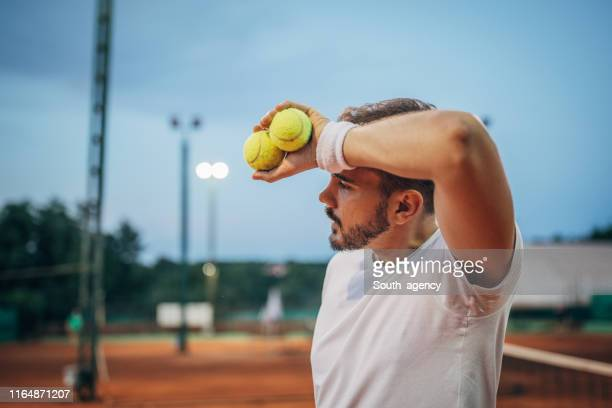 tired tennis player on court - tennis player stock pictures, royalty-free photos & images