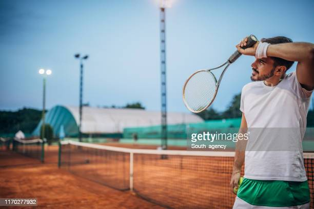tired tennis player on court - south_agency stock pictures, royalty-free photos & images