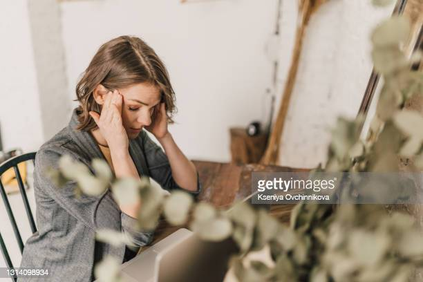 a tired woman in front of a laptop - 35 39 years stock pictures, royalty-free photos & images