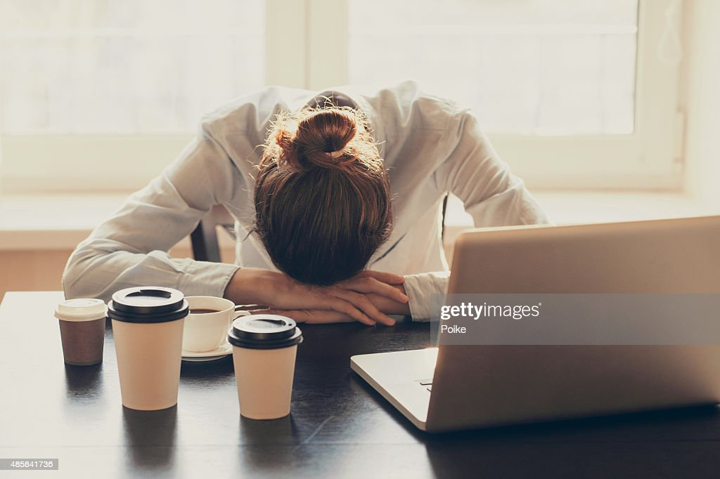 Tired woman in the office : Stock Photo