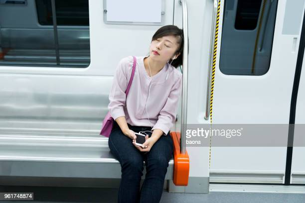 Tired woman listening music and sleeping