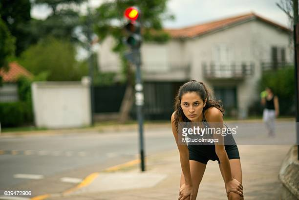 tired woman resting after running - hot latina women stock photos and pictures