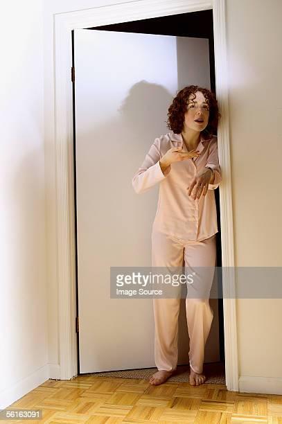 Tired woman standing in doorway