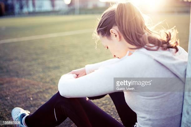 Tired women relaxing on sports field