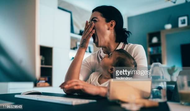tired working mother - yawning stock pictures, royalty-free photos & images