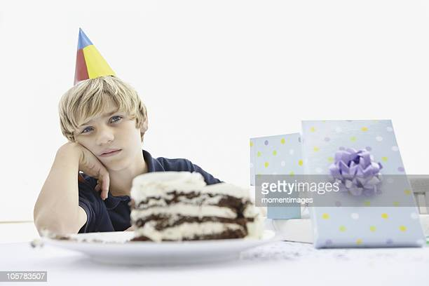 Tired young boy at a birthday party