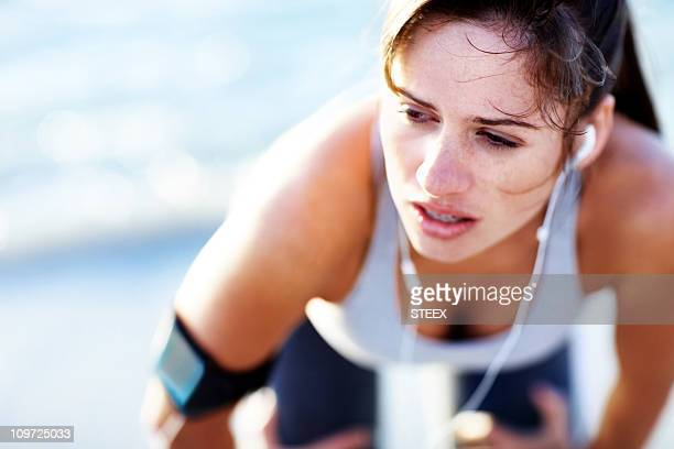 tired young caucasian woman after a jog - bending over stock pictures, royalty-free photos & images