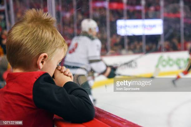 A tired young fan rubs his eyes during the first period of an NHL game where the Calgary Flames hosted the Minnesota Wild on December 6 at the...