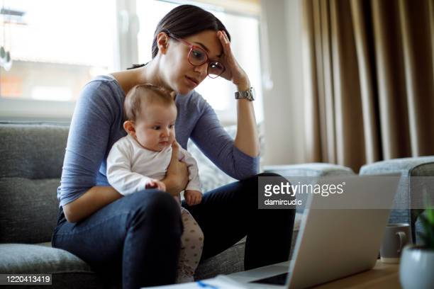tired young mother working from home - single mother stock pictures, royalty-free photos & images