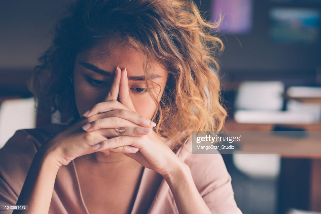 Tired Young Woman Leaning Head on Hands : Stock Photo