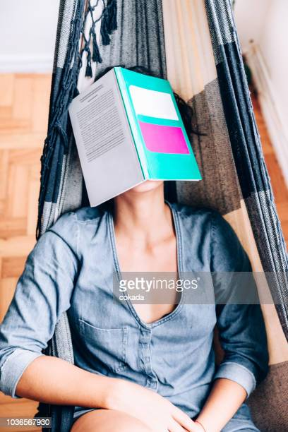 tired young woman sleeping with book